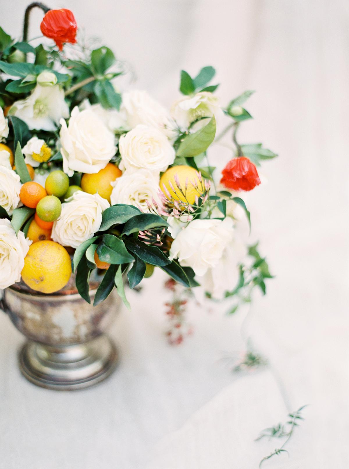 Rose, Poppy & Citrus Floral Arrangement by Fleuropean. Photography by Ashley Ludaescher