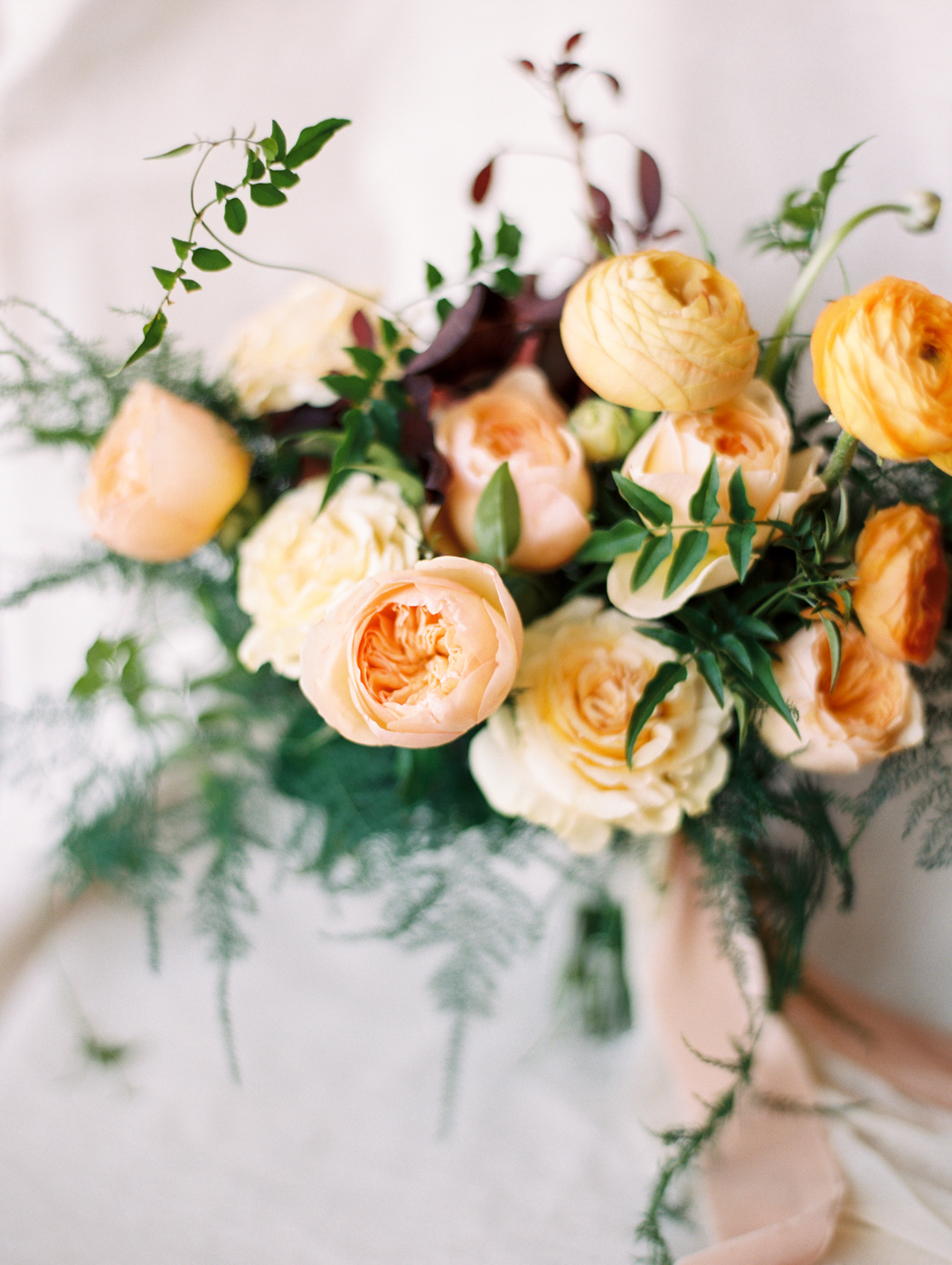 Garden Rose and Ranunculus Bridal Bouquet by Wilder Floral Co.