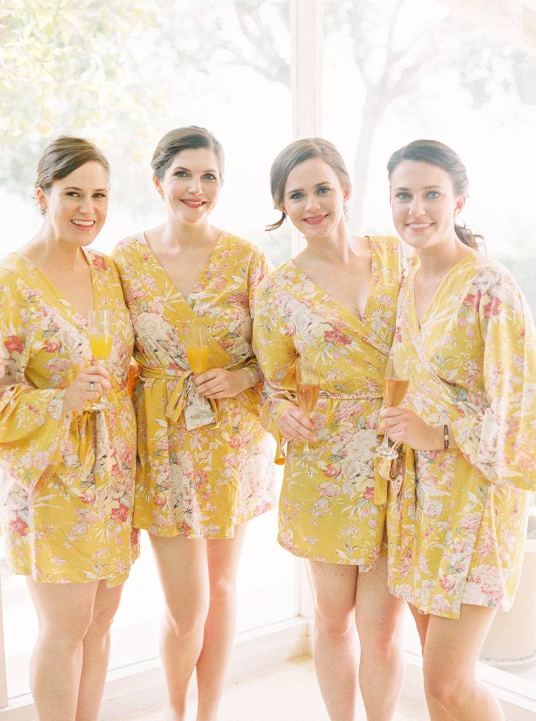 Bride and her Bridesmaids in yellow Pretty Plum Sugar floral robes