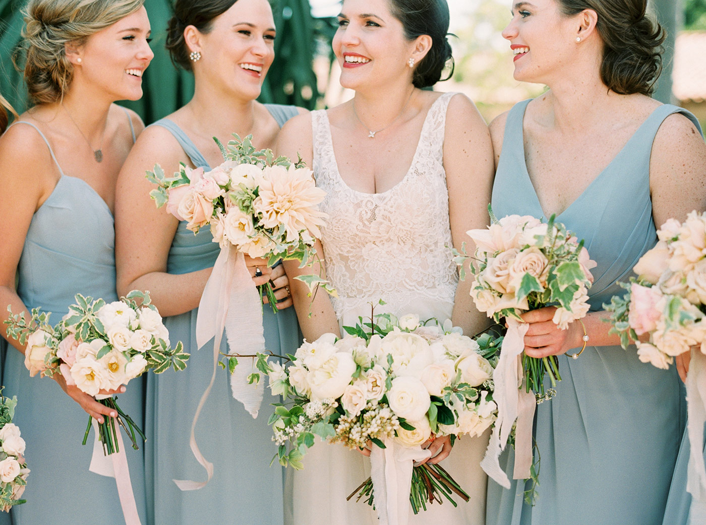 Bride and Bridesmaids with White and Pastel toned bouquets
