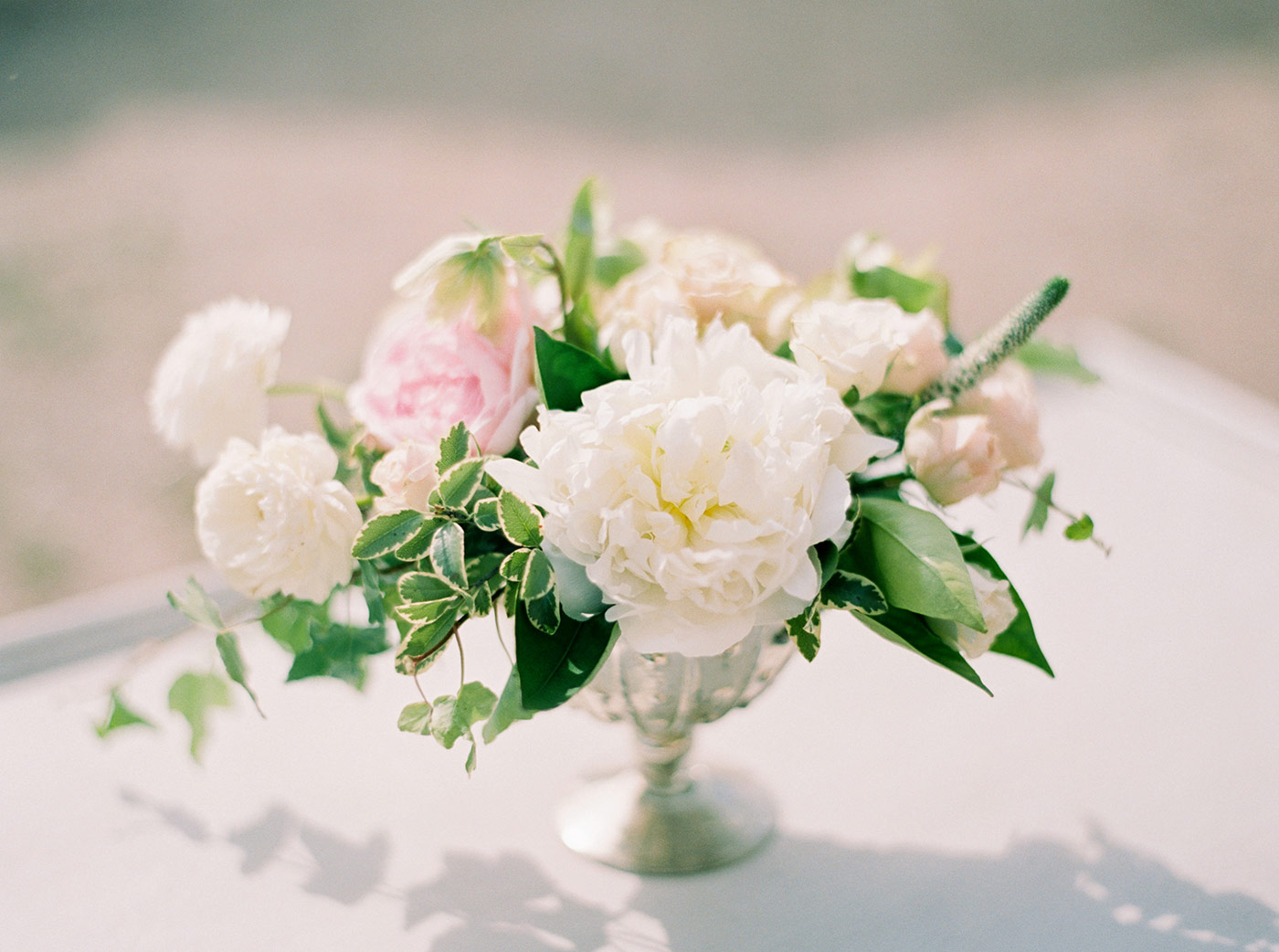 White, Pink and Green Floral Arrangement by Noonan's Wine Country Designs
